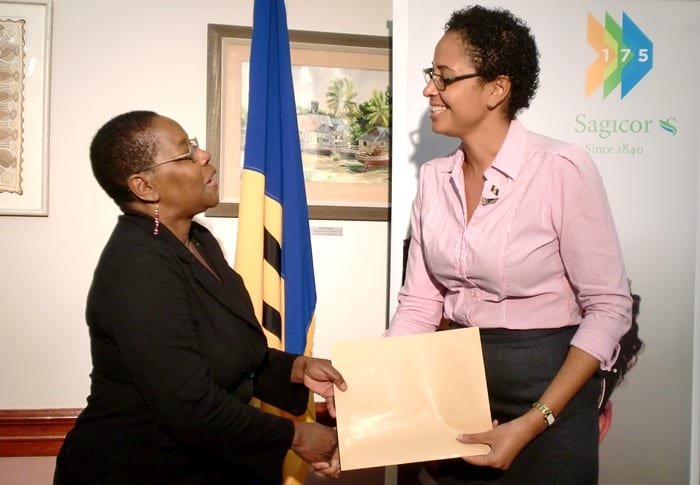 Permanent Secretary, Ministry of Culture, Sports and Youth, Ruth Blackman (left) receiving the sponsorship cheque for the Lighting Ceremony from Marketing Officer at Sagicor Life Inc., Folayan Taitt today. (Photograph courtesy Tanya Lightbourne/Barbados Advocate)