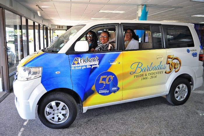Head of the 50th Anniversary of Independence Celebrations Secretariat, Gabrielle Springer; Web Content Officer, Sharifa Medford and Volunteer, Fernella Cordle head to the office in the new Suzuki Vehicle donated by Simpson Motors today. (A.Miller/BGIS)