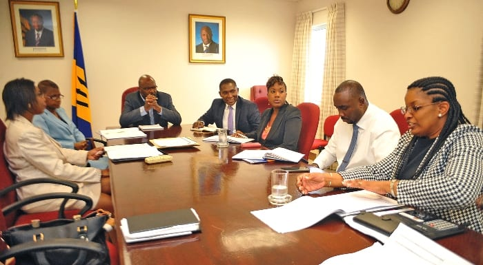 Attorney General, Adriel Brathwaite (head of table) and Barbados' Ambassador to the United States, Selwin Hart (to the Minister's left) listening to Manager of the National Council on Substance Abuse, Betty Hunte during a recent meeting at his Wildey, St. Michael. (A.Miller/BGIS