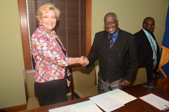 Chief Justice, Sir Marston Gibson, and Director of the JURIST project, Dr. Penny Reedie, shaking hads following the signing of a Memorandum of Understanding to formalise the agreement. (C.Pitt/BGIS