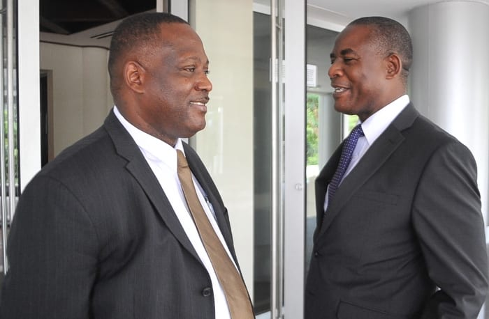 International Business Minister, Donville Inniss chatting with ICAB Executive Director, Reginald Farley, at ICAB's 23rd Annual Conference at the Lloyd Erskine Sandiford Centre today.(A.Miller/BGIS)