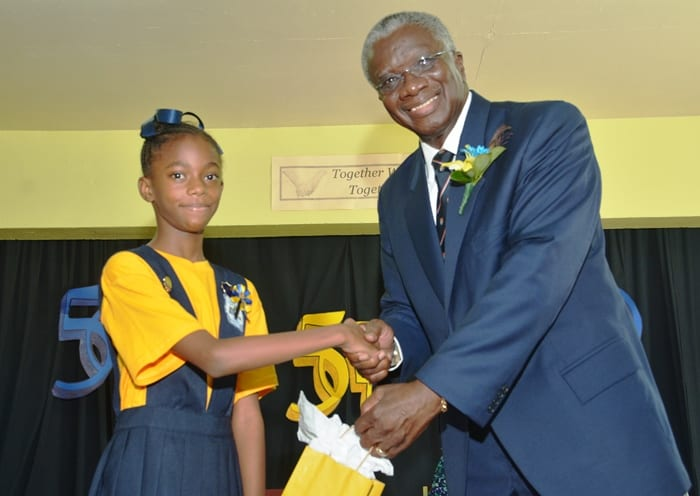 Prime Minister Freundel Stuart receiving a gift from head girl of St. Bartholomew's Primary, Janae Jordan-White during a visit to the school today. Mr. Stuart addressed students on the topic 'A day in the life of a Prime Minister'. (B.Hinds/BGIS)