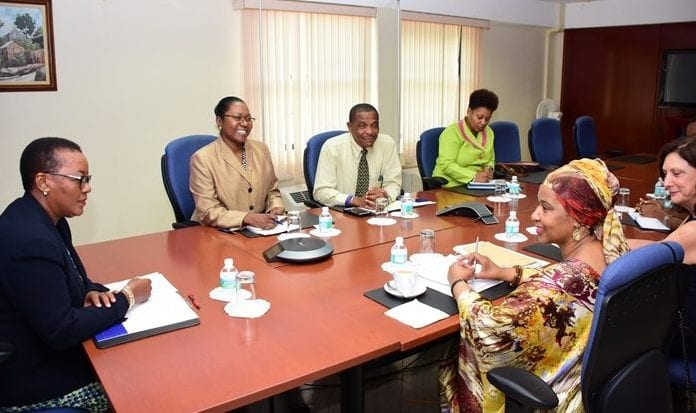 Foreign Minister, Maxine McClean (left) and Executive Director of UN Women Phumzile Mlambo-Ngeuka (right) discussing the issue of women and leadership during their recent meeeting while officials look on. (C.Pitt/BGIS)