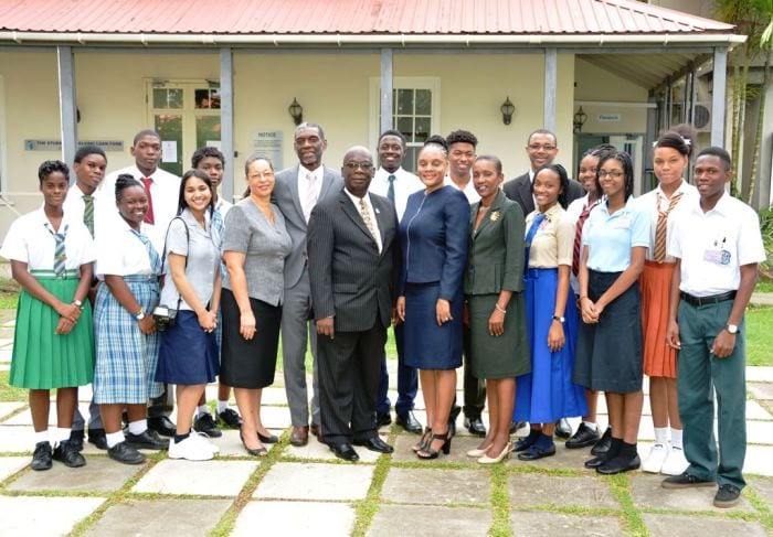 Education Minister, Ronald Jones (centre) and education officials pose with the top CXC students in the region at the Ministry today. (B.Hinds/BGIS)