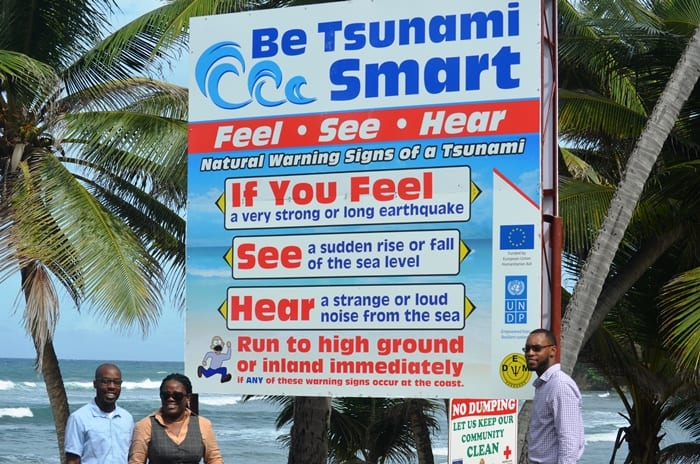 DEM Director, Kerry Hinds, (second from left) and UNDP and Barbados Red Cross officials standing by the Tsunami Smart Sign yesterday. (Photographs compliments the UNDP)