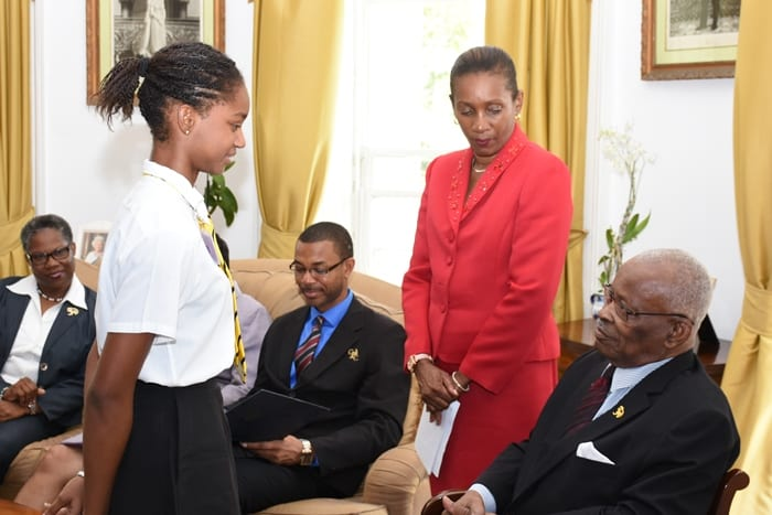 Awardee of CXC's Natural Science prize for CAPE, Larissa Wiltshire of Queen's College, Guyana, greeting the Governor-General of Barbados, Sir Elliott Belgrave in the presence of Permanent Secretary in the Ministry of Education, June Chandler. Also featured are Deputy Chief Education Officer, Joy Adamson (left) and CXC Assistant Registrar and Communication Specialist, Cleveland Sam. (A.Gaskin/BGIS)