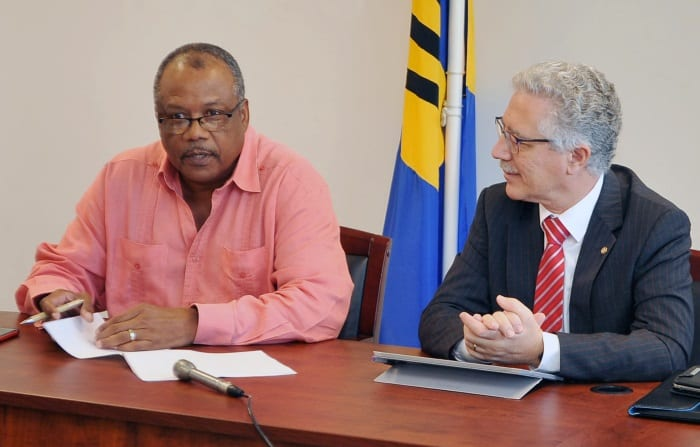 Minister of Health, John Boyce speaking at a media briefing today. Looking on is PAHO/WHO Representative for Barbados and the Eastern Caribbean, Dr. Godfrey Xuereb. (A.Miller/BGIS)