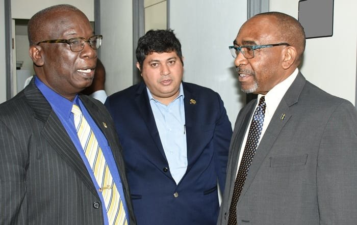 Minister of Education, Ronald Jones (left) and Minister in the Prime Minister's Office, Senator Darcy Boyce (right) in conversation with President of the American University of Barbados, Meesan Ali Khan, following the announcement of the AUB's purchase of the BET property at Wildey, St. Michael. (A.Gaskin/BGIS)