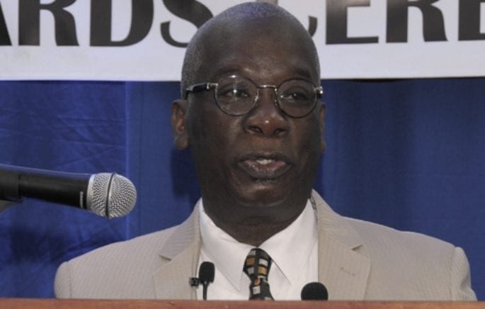 Minister of Education, Science, Technology and Innovation, Ronald Jones, addresses students of the American University of Barbados (AUB) at the Orientation and Awards Ceremony. (C.Pitt/BGIS)