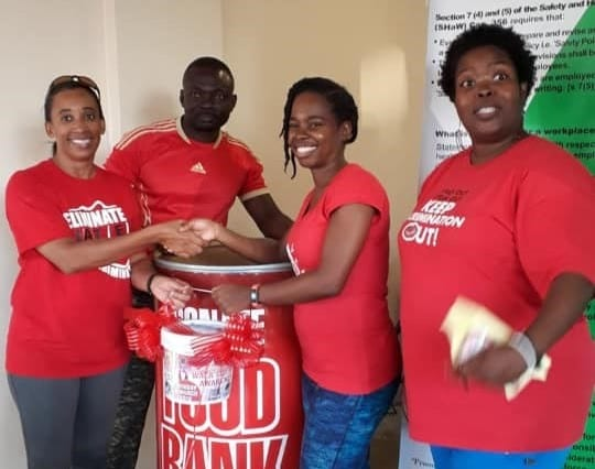 Workers Walk & Give To HIV Food Bank