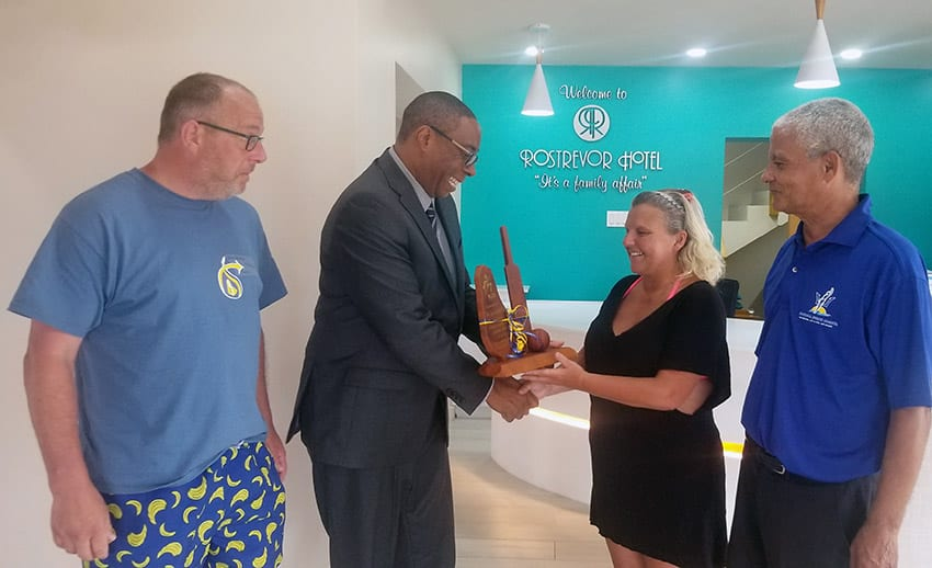 Minister Presents Plaque To Cricket Loving Couple